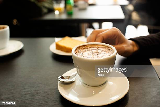 young woman having a coffee drink - coffee drink stock pictures, royalty-free photos & images