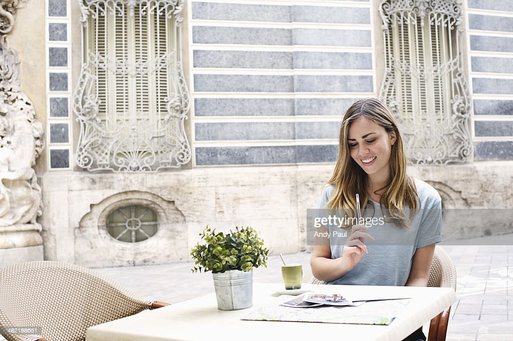 Young woman having a coffee outside Museum of Ceramics, Valencia, Spain : Stock Photo