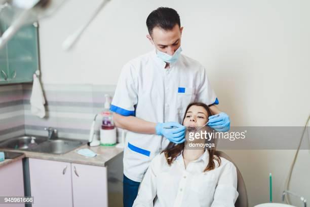 young woman having dental checkup dental