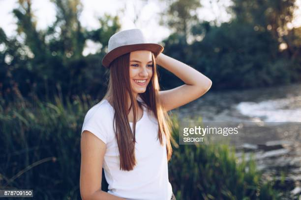 young woman having a good time in nature - spring flowing water stock pictures, royalty-free photos & images