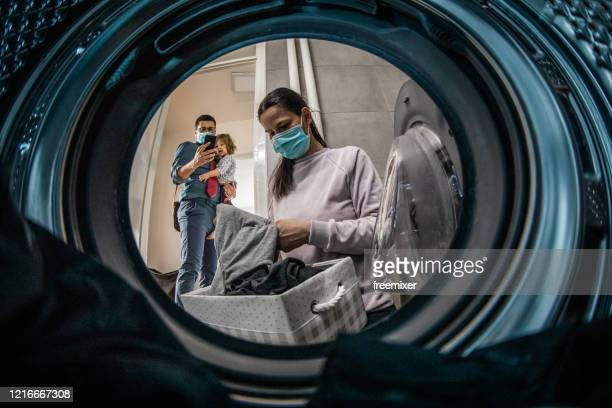 young woman having a laundry day - illness prevention stock pictures, royalty-free photos & images