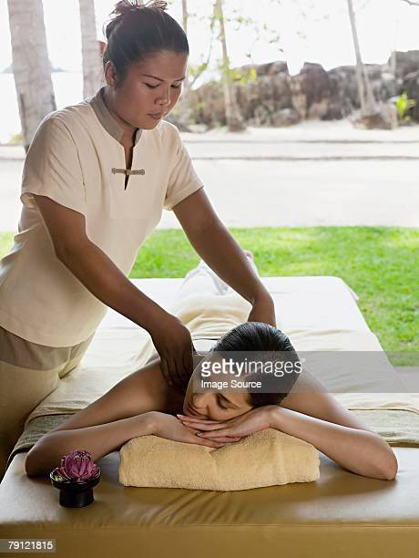 young woman having a massage - thai massage stock photos and pictures