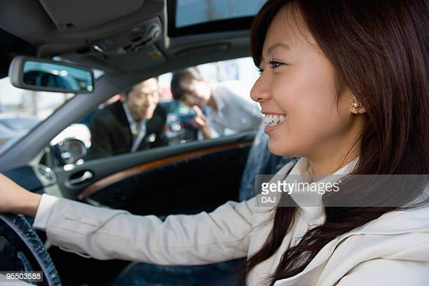 a young woman having a test ride - 試運転 ストックフォトと画像