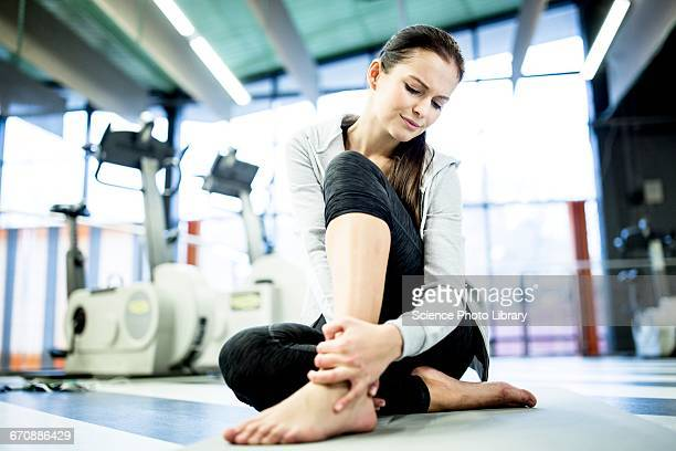 young woman having ankle pain - ankle stock pictures, royalty-free photos & images