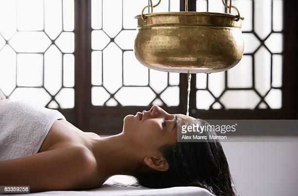 young woman having Ayurvedic spa treatment