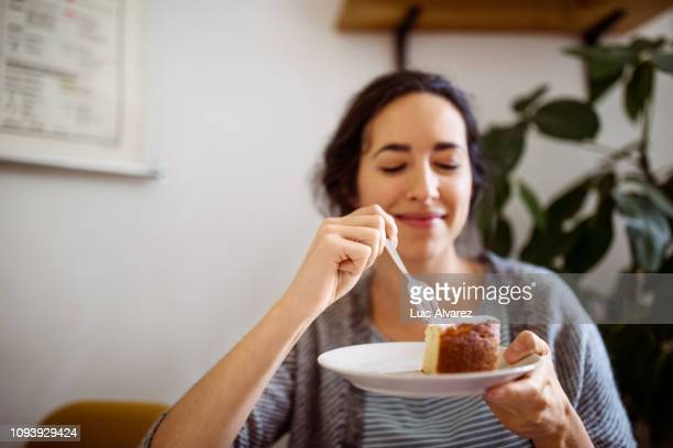 young woman having breakfast at home - dessert sweet food stock pictures, royalty-free photos & images