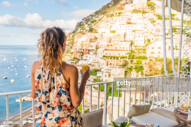 Young woman having breakfast in Positano
