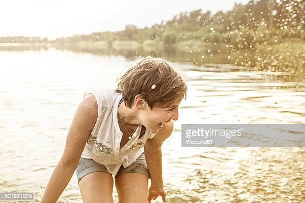 Young woman having fun at quarry pond