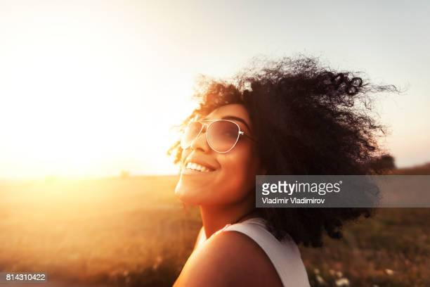 Young woman having fun at sunset