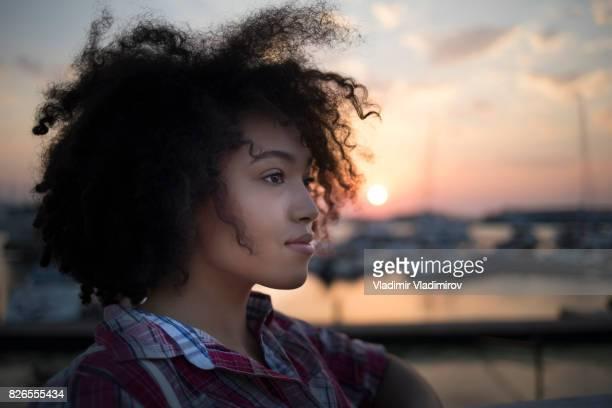 Young woman having fun at sunset