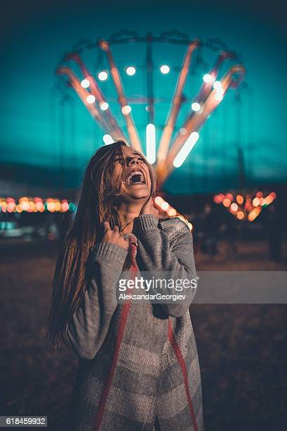 Young Woman Having Fun in Amusement Park Fair at Night