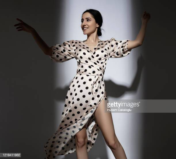young woman having fun with polka dot dress - long dress stock pictures, royalty-free photos & images