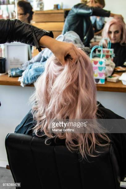 young woman having her hair done - dyed hair stock pictures, royalty-free photos & images