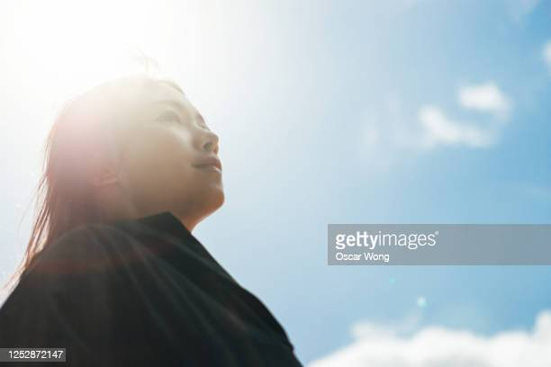 young woman having hope for the future - hope stock pictures, royalty-free photos & images