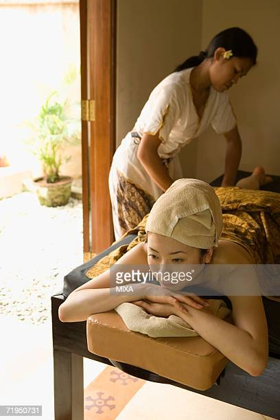 Young woman having leg massage