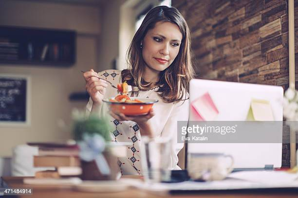Young woman having lunch break