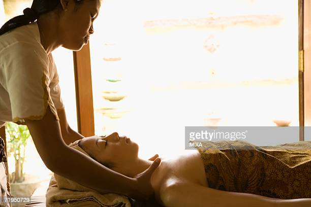 Young woman having neck massage