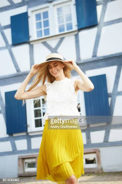 young woman having picnic in park - white skirt stock pictures, royalty-free photos & images
