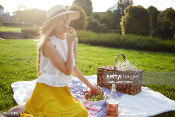 Young woman having picnic in park