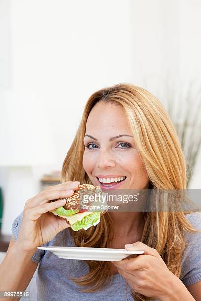 young woman having sandwich