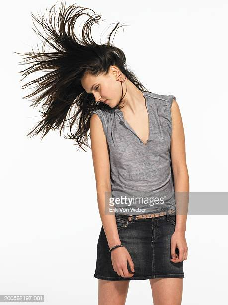 Young woman head banging
