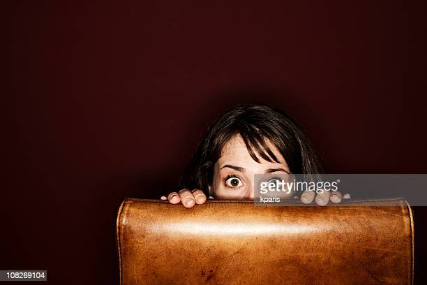 young woman hiding - chairperson stock pictures, royalty-free photos & images