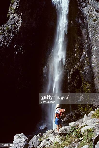 Young Woman Hiker Enjoying a Waterfall