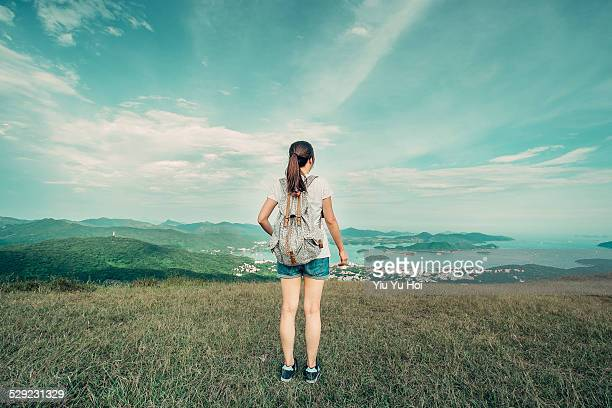 Young woman hiker looking over the landscape