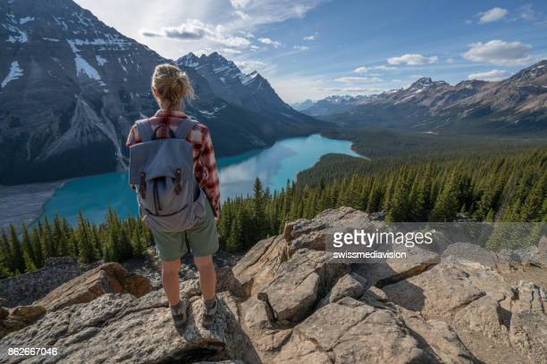 Young woman hiker on top of mountain