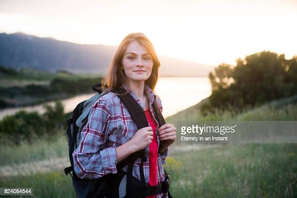 MS Young woman hiking by a lake