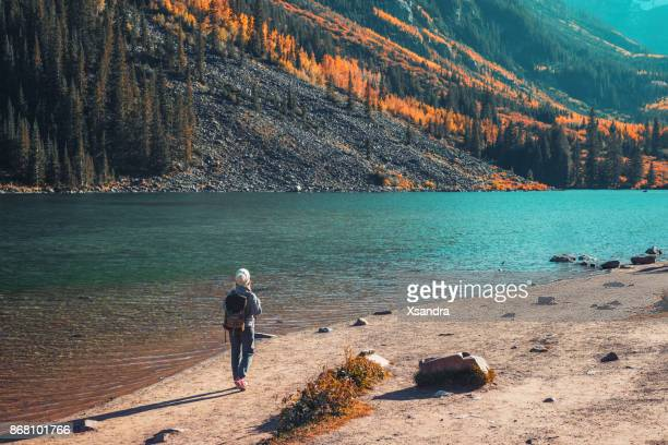 young woman hiking in aspen, colorado - aspen colorado stock photos and pictures