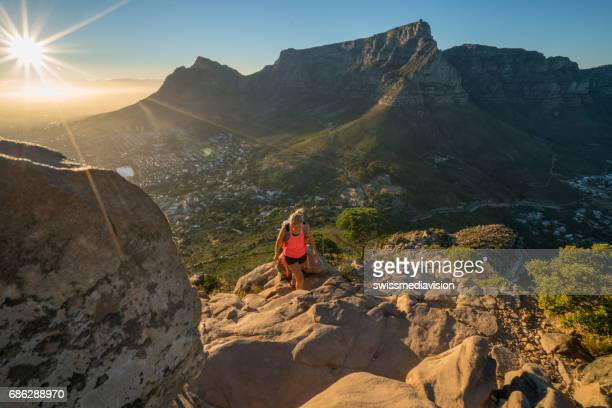 young woman hiking in cape town at sunrise - table mountain stock pictures, royalty-free photos & images