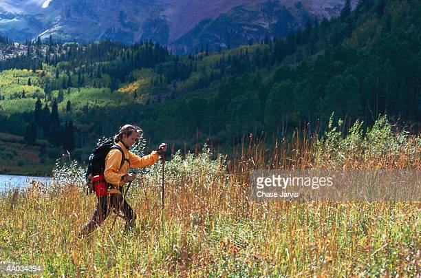 young woman hiking in maroon bells, colorado - maroon bells stock photos and pictures
