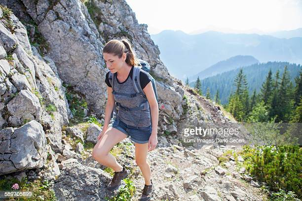 Young woman hiking in mountain landscape