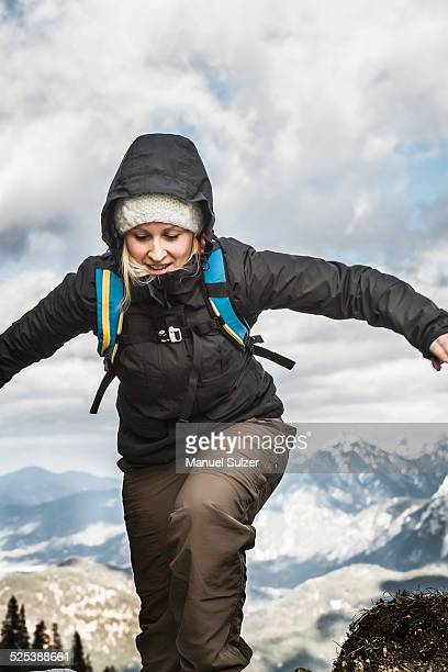 Young woman hiking in mountains, Hundsarschjoch, Vils, Bavaria, Germany
