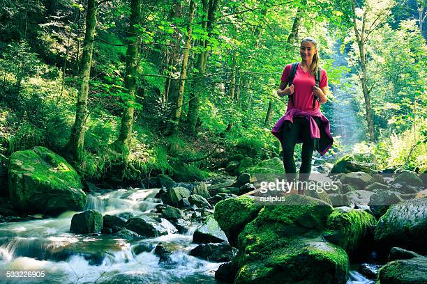 young woman hiking in the forest
