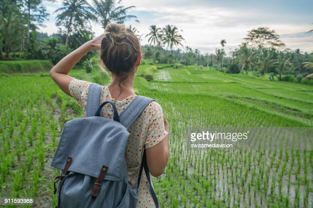 Young woman hiking in the rice terrace, Ubud- Bali