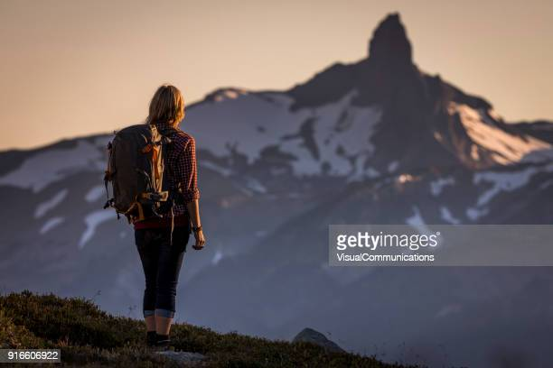 young woman hiking in whistler backcountry. - whistler british columbia stock pictures, royalty-free photos & images