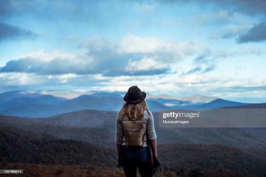 Young woman hiking through beautiful mountains. : Stock Photo