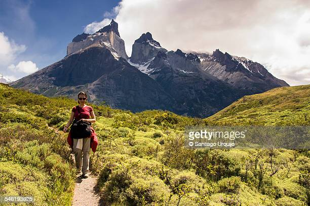 Young woman hiking Torres del Paine National Park