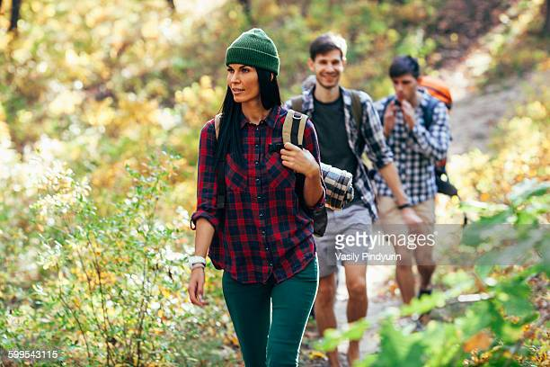 Young woman hiking with friends in forest