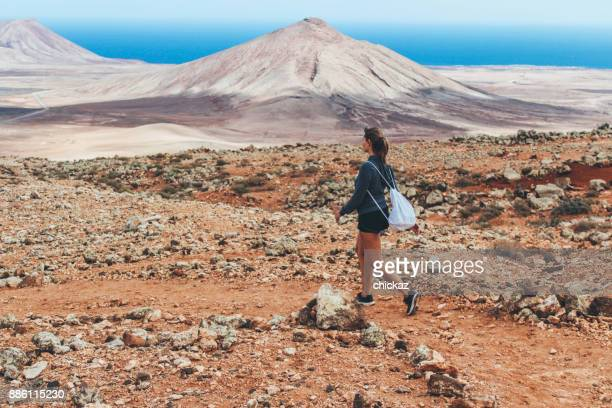 Young woman hiking with panoramic view on volcano
