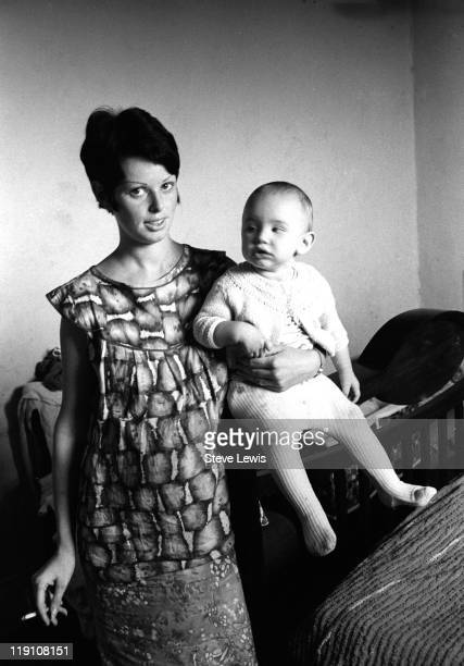 A young woman holding a baby east London circa 1970