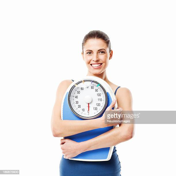 Young Woman Holding a Bathroom Scale - Isolated