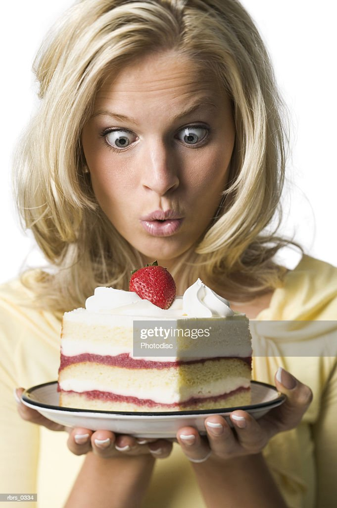 Young woman holding a birthday cake : Foto de stock