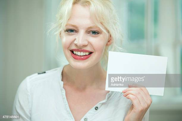 young woman holding a blank card - blank sign stock photos and pictures