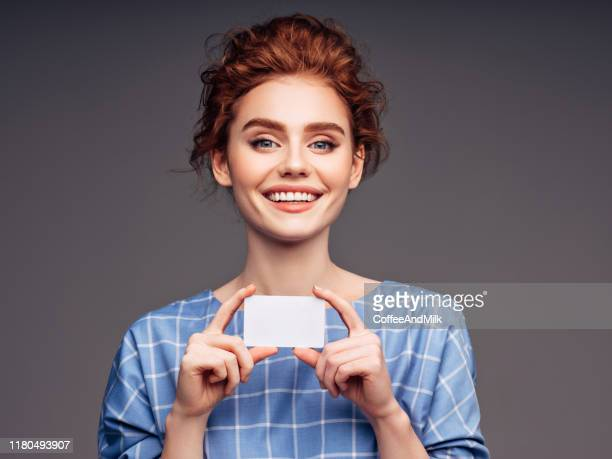 young woman holding a business card - thinking of you card stock pictures, royalty-free photos & images