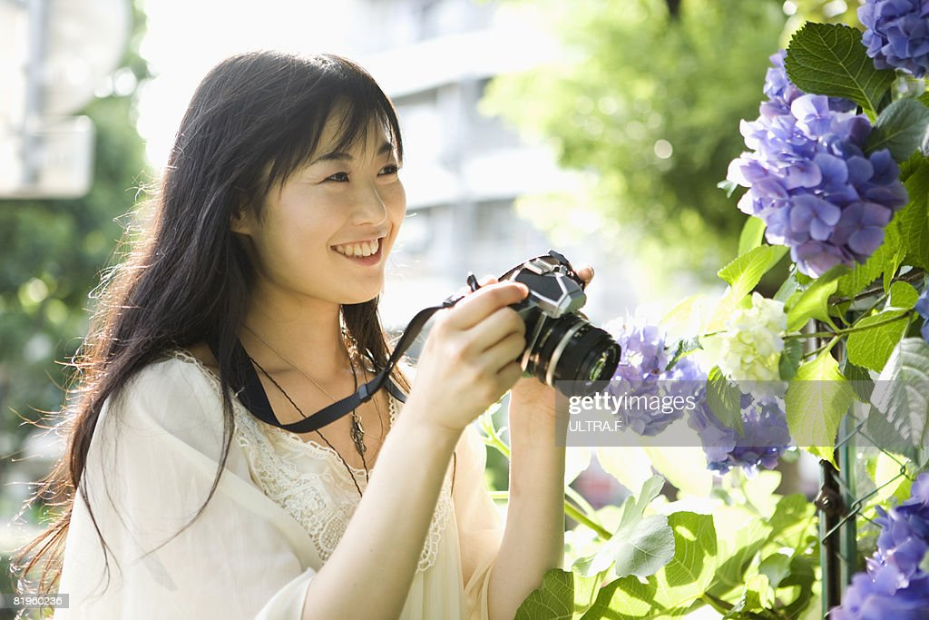 Young Woman holding a camera : Stock Photo
