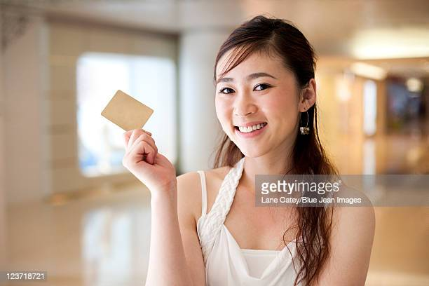 Young Woman Holding a Credit Card