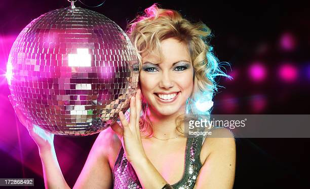 Young Woman holding a disco ball